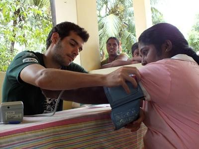 A Sri Lankan woman gets a health check from a Projects Abroad volunteer.