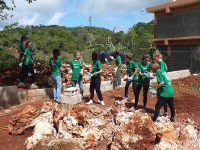 Projects Abroad volunteers build a new playground to contribute to children's development at a care center in Jamaica.